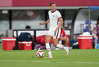 TOKYO, JAPAN - JULY 20: Christen Press #11 of the United States looking for an open man during a game between Sweden and USWNT at Tokyo Stadium on July 20, 2021 in Tokyo, Japan.