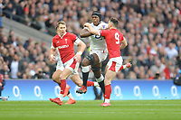 Maro Itoje of England is stopped by Tomos Williams of Wales during the Guinness Six Nations match between England and Wales at Twickenham Stadium on Saturday 7th March 2020 (Photo by Rob Munro/Stewart Communications)