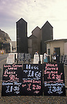 Hastings East Sussex . Fishermans huts, price boards. Inshore fishing industry. 1980s UK.