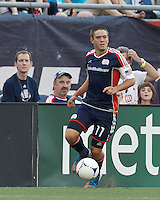 New England Revolution midfielder Kelyn Rowe (11) looks to pass. In a Major League Soccer (MLS) match, New England Revolution defeated New York Red Bulls, 2-0, at Gillette Stadium on July 8, 2012.