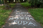 Children's first names chalked on to a pavement in a park, London SW20. Bubu, Helena, Marietta and Ruda. The changing face of Britain. 2021.