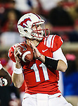 Southern Methodist Mustangs quarterback Garrett Gilbert (11) in action during the game between the University of Houston Cougars and the Southern Methodist Mustangs at the Gerald J. Ford Stadium in Dallas, Texas. SMU defeats Houston 72 to 42.