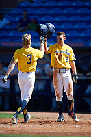 Michigan Wolverines Jonathan Engelmann (2) congratulates Miles Lewis (3) after a home run during a game against Army West Point on February 17, 2018 at Tradition Field in St. Lucie, Florida.  Army defeated Michigan 4-3.  (Mike Janes/Four Seam Images)