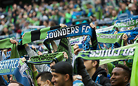 SEATTLE, WA - NOVEMBER 10: Seattle Sounders fans hold up scarves during a game between Toronto FC and Seattle Sounders FC at CenturyLink Field on November 10, 2019 in Seattle, Washington.