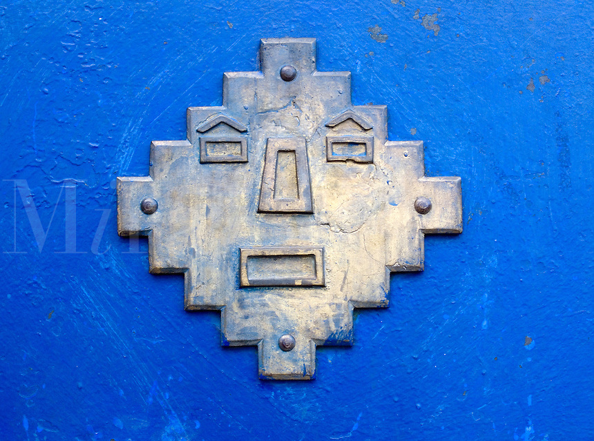 Metalwork on blue door, Cuzco, Peru