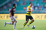 Borussia Dortmund Midfielder Felix Passlack (R) fights for the ball with AC Milan Midfielder Jose Sosa (L) during the International Champions Cup 2017 match between AC Milan vs Borussia Dortmund at University Town Sports Centre Stadium on July 18, 2017 in Guangzhou, China. Photo by Marcio Rodrigo Machado / Power Sport Images
