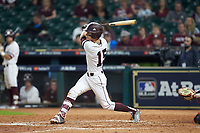 Jake Mangum (15) of the Mississippi State Bulldogs follows through on his swing against the Houston Cougars in game six of the 2018 Shriners Hospitals for Children College Classic at Minute Maid Park on March 3, 2018 in Houston, Texas. The Bulldogs defeated the Cougars 3-2 in 12 innings. (Brian Westerholt/Four Seam Images)