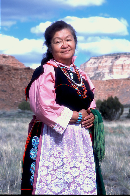 Zuni woman, Lena Tsethlikia, models her traditional Zuni clothing on location with famous Corn Mountain in the background in Zuni New Mexico