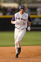 Devin Harris #34 of the East Carolina Pirates rounds the bases following his first inning home run versus the Elon Phoenix at Clark-LeClair Stadium March 29, 2009 in Greenville, North Carolina. (Photo by Brian Westerholt / Four Seam Images)
