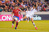 HOUSTON, TX - FEBRUARY 03: Fabiola Sanchez #5 of Costa Rica battles with Christen Press #20 of the United States for a ball during a game between Costa Rica and USWNT at BBVA Stadium on February 03, 2020 in Houston, Texas.