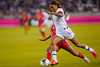 HOUSTON, TX - JANUARY 31: Jessica McDonald #14 of the United States moves with the ball past Yerenis  De Leon #5 of Panama during a game between Panama and USWNT at BBVA Stadium on January 31, 2020 in Houston, Texas.