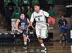 North Texas Mean Green guard Chris Jones (5) in action during the NCAA  basketball game between the St. Gregory Cavilers and the University of North Texas Mean Green at the North Texas Coliseum,the Super Pit, in Denton, Texas. UNT defeated St. Gregory's 81 to 52...