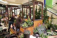 """A long-exposure image of students frantically working to finish Orange Coast College's Ornamental Horticulture Club's in-progress installation at the 2012 South Coast Plaza Spring Garden Show in Costa Mesa, CA.  The theme for this year's show is """"healing gardens"""", and the OCC team is installing a """"garden for the blind,"""" which will be complete with a braille world globe and braille labels.  This picture was taken Tuesday April 25, 2012 at ~11pm, as the team was working to meet their Thursday-morning deadline."""