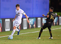 LAKE BUENA VISTA, FL - JULY 18: Emil Cuello #27 of LA Galaxy dribbles away from Mark-Anthony Kaye #14 of LAFC during a game between Los Angeles Galaxy and Los Angeles FC at ESPN Wide World of Sports on July 18, 2020 in Lake Buena Vista, Florida.