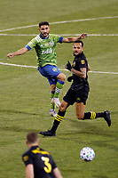 COLUMBUS, OH - DECEMBER 12: Cristian Roldan #7 of Seattle Sounders FC kicks the ball against Columbus Crew during a game between Seattle Sounders FC and Columbus Crew at MAPFRE Stadium on December 12, 2020 in Columbus, Ohio.