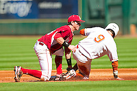 Tim Maitland #9 of the Texas Longhorns is tagged out at second base by Arkansas Razorbacks shortstop Tim Carver #18 at Minute Maid Park on March 4, 2012 in Houston, Texas.  The Razorbacks defeated the Longhorns 7-3.  Brian Westerholt / Four Seam Images