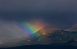 A beautiful rainbow adorns the rugged North Mongolian Mountains, which separate Mongolia from Siberia. Rainbows can last for as long as an hour, or, in this case, only a few seconds.