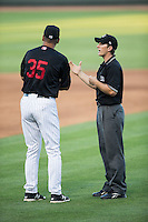 Umpire Chris Marco explains his call to Winston-Salem Dash manager Joel Skinner (35) during the game against the Salem Red Sox at BB&T Ballpark on June 16, 2016 in Winston-Salem, North Carolina.  The Dash defeated the Red Sox 7-1.  (Brian Westerholt/Four Seam Images)