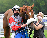 Winner of The Swallowcliffe Handicap (Div 1) Burguillos  ridden by Eoin Walsh and trained by Luke McJannet in the Winners enclosure during Horse Racing at Salisbury Racecourse on 13th August 2020