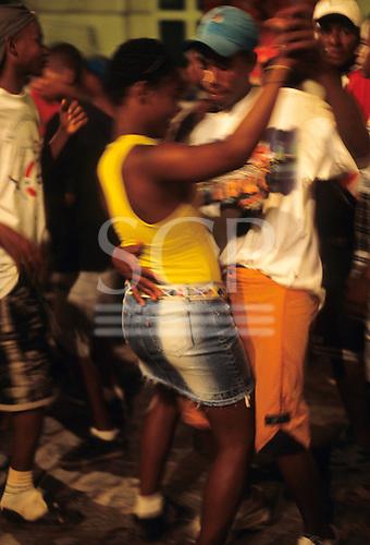 Salvador, Bahia State, Brazil. Couple dancing close.