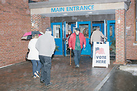 People arrive for Merrimack Ward 1 Primary Voting at James Mastricola Upper Elementary School in Merrimack, New Hampshire, on Tue., Feb. 11, 2020.