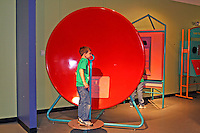 Boy at sound dish interactive exhibit Mary Brogan Museum of Art and Science Tallahassee Florida