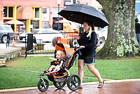 Elizabeth Ganey holds an umbrella over herself and her daughter Bridget, 2, Thursday, September 10, 2020, as they cross the square in downtown Bentonville. The two were headed to the playground inside the two acre Dave Peel Park located downtown. Check out nwaonline.com/200911Daily/ and nwadg.com/photos for a photo gallery.<br /> (NWA Democrat-Gazette/David Gottschalk)