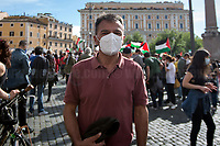"""Stefano Fassina MP (Italian economist and politician), Member of Parliament for LeU, Liberi e Uguali.<br /> <br /> Rome, Italy. 15th May, 2021. Today, thousands of Pro-Palestinian activists and members of the public gathered in Piazza dell'Esquilino to mark the 73rd Anniversary of """"Nakba"""" («The 1948 Palestinian exodus, also known as the Nakba literally """"disaster"""", """"catastrophe"""", or """"cataclysm"""", occurred when more than 700,000 Palestinian Arabs fled or were expelled from their homes, during the 1948 Palestine war […]», 1.); to show support and solidarity to the Palestinian People; to protest against the crisis between Palestinian people and the Israeli armed forces which began on the 6th of May 2021 with the decision of the Israeli Supreme Court to evict four Palestinian families from the East Jerusalem neighborhood of Sheikh Jarrah, part of the Palestinian Territories under international law. The protests quickly escalated in an asymmetric conflict between Israeli Air Forces airstrikes and Hamas' rockets fired from the Gaza Strip which killed at least 190 Palestinians, including 41 children, and 10 Israelis, including 2 children. The demonstration in Rome - organised by the Palestinian Community of Rome and Lazio (2.) - culminated with a peaceful march which ended outside the Colosseum, while Similar demonstrations were held in the major cities across the globe.<br /> <br /> Footnotes & Links:<br /> 1. (Source Wikipedia.org. ENG) https://en.wikipedia.org/wiki/1948_Palestinian_exodus<br /> 2. https://www.facebook.com/groups/sandoga/<br /> Other Organizations involved: http://www.assopacepalestina.org/ & http://bit.do/frfpo<br /> For Live Updates (Source, Aljazeera.com ENG): https://www.aljazeera.com/news/2021/5/16/more-deaths-gaza-israel-launches-most-intense-raids-yet"""