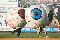 Three eye balls race to the finish line to try and win a prize for their designated section of fans between innings of a Carolina League game at Ernie Shore Field in Winston-Salem, NC, Thursday, June 15, 2006.  Winston-Salem defeated Frederick 1-0 in game 1 of a double-header.
