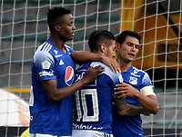 BOGOTA - COLOMBIA, 18-04-2021: David Macalister Silva de Millonarios F. C. celebra con sus compañeros de equipo despues de anotar el segundo gol a Deportivo Cali durante partido entre Millonarios F. C. y Deportivo Cali de la fecha 19 por la Liga BetPlay DIMAYOR I 2021 jugado en el estadio Nemesio Camacho El Campin de la ciudad de Bogota. / David Macalister Silva of Millonarios F. C. celebrates with his teammates after scoring the secong goal to Deportivo Cali during a match between Millonarios F. C. and Deportivo Cali of the 19th date for the BetPlay DIMAYOR I 2021 League played at the Nemesio Camacho El Campin Stadium in Bogota city. / Photo: VizzorImage / Luis Ramirez / Staff.