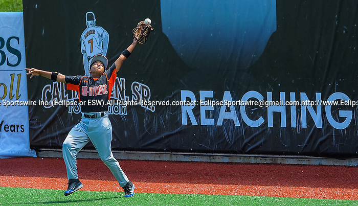 Bronx(NY)'s Joshua Russo tries to make a catch during the Cal Ripken Babe Ruth World Series in Aberdeen, Maryland on August 12, 2012