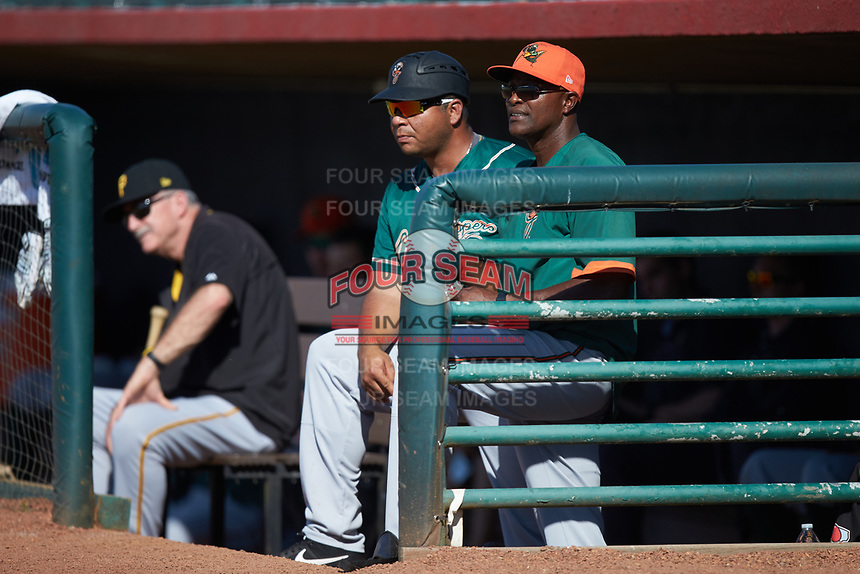 Greensboro Grasshoppers pitching coach Stan Kyles (right) and manager Miguel Perez (left) watch the action from the dugout during the game against the Hickory Crawdads at L.P. Frans Stadium on May 26, 2019 in Hickory, North Carolina. The Crawdads defeated the Grasshoppers 10-8. (Brian Westerholt/Four Seam Images)