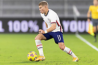 ORLANDO CITY, FL - JANUARY 31: Chris Mueller #11 of the United States moves with the ball during a game between Trinidad and Tobago and USMNT at Exploria stadium on January 31, 2021 in Orlando City, Florida.