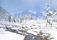 A winter strom receeds over the Maroon Bells, near Aspen, Colorado.