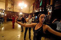 Valeria Zunino, 27(1R) a tango teacher, shows to her students how to perform a tango steps at the Ideal tea house, in Buenos Aires, Argentina, April 25, 2003. Opened in 1912 the Ideal tea house remains one of the symbols of tango through the years Photo by Quique Kierszenbaum