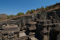 Kailash Temple at Ellora Caves Aurangabad, India.Kailash Temple, also Kailasa Temple is one of the 34 monasteries and temples, extending over more than 2km, that were dug side by side in the wall of a high basalt cliff in the complex located at Ellora, Maharashtra, India. Of these 34 monasteries and temples, the Kailasa (cave 16) is a remarkable example of Indian rock-cut architecture on account of its striking proportion; elaborate workmanship architectural content and sculptural ornamentation.. It is designed to recall Mount Kailash, the abode of Lord Shiva[2]. While it exhibits typical Dravidian features, it was carved out of one single rock. It was built in the 8th century by the Rashtrakuta king Krishna I..The Kailash Temple is notable for its vertical excavation-carvers started at the top of the original rock, and excavated downward, exhuming the temple out of the existing rock. The traditional methods were rigidly followed by the master architect which could not have been achieved by excavating from the front. The architects found to design this temple were from the southern Pallava kingdom.. Cave10 in AjantaCavescontains theoldest Indian paintingsof historical period, made around the 1st century BC.<br /> <br /> ThecavesatAjantadate from the 2nd century B.C.E. to 650 C.E andwerecut into the mountainside in two distinct phases. Discovered by chance in 1819 by British soldiers on a hunt, theAjanta Caveshave become an icon of ancient Indian art, and have influenced subsequent artists and styles.<br /> <br />