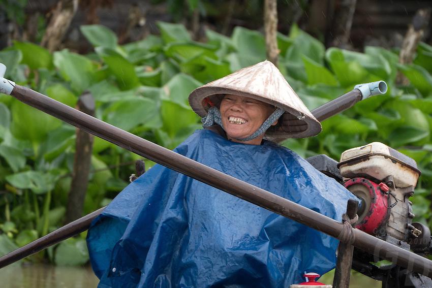 Happy Boat driver. Life in the Mekong Delta Vietnam