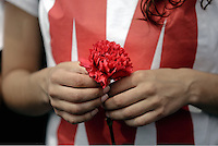 Pictured: A female left wing supporter holding a red carnation Sunday 08 May 2016<br /> Re: Members of left wing parties gather outside the Greek Parliament, while MPs vote on pension and welfare reforms, Athens, Greece