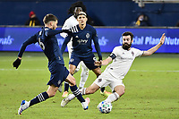 KANSAS CITY, KS - OCTOBER 24: Ilie Sanchez #6 of Sporting Kansas City challenged by Jack Price #19 Colorado Rapids  during a game between Colorado Rapids and Sporting Kansas City at Children's Mercy Park on October 24, 2020 in Kansas City, Kansas.