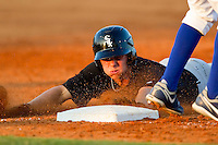 Collin Kuhn #36 of the Bristol White Sox slides head first into third base against the Burlington Royals at Burlington Athletic Park on July 10, 2011 in Burlington, North Carolina.  The White Sox defeated the Royals 4-3.   (Brian Westerholt / Four Seam Images)