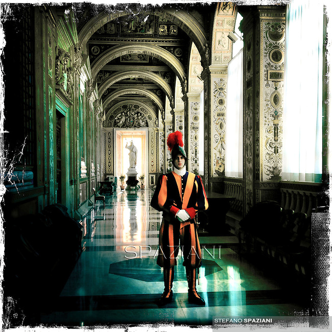 The Pontifical Swiss Guard Corps of the, the Vatican Apostolic Palace. Pontifical Swiss Guard, Responsible for the safety of the Pope, Including the security of the Apostolic Palace. It Serves as the de facto military of Vatican CityPope Benedict XVI during the audience to the Curia for Christmas greetings, in the Sala Clementina of the Apostolic Palace, in the Vatican City, 22 December 2011