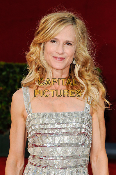 HOLLY HUNTER.Arrivals at the 61st Primetime Emmy Awards held at Te Nokia Theater in Los Angeles, California, USA. .September 20st, 2009 .emmys  half length silver dress veins arms .CAP/ROT.©Lee Roth/Capital Pictures