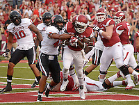 NWA Democrat-Gazette/BEN GOFF @NWABENGOFF<br /> Alex Collins, Arkansas running back, breaks the tackle of Texas Tech linebacker Dakota Allen to score in the first quarter on Saturday Sept. 19, 2015 during the game in Razorback Stadium in Fayetteville.