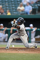 Dayton Dragons designated hitter Jamodrick McGruder (4) attempts a bunt during a game against the South Bend Silver Hawks on August 20, 2014 at Four Winds Field in South Bend, Indiana.  Dayton defeated South Bend 5-3.  (Mike Janes/Four Seam Images)