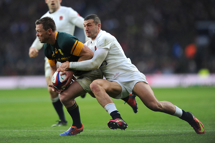 Jonny May of England wraps up Ruan Combrinck of South Africa during the Old Mutual Wealth Series match between England and South Africa at Twickenham Stadium on Saturday 12th November 2016 (Photo by Rob Munro)