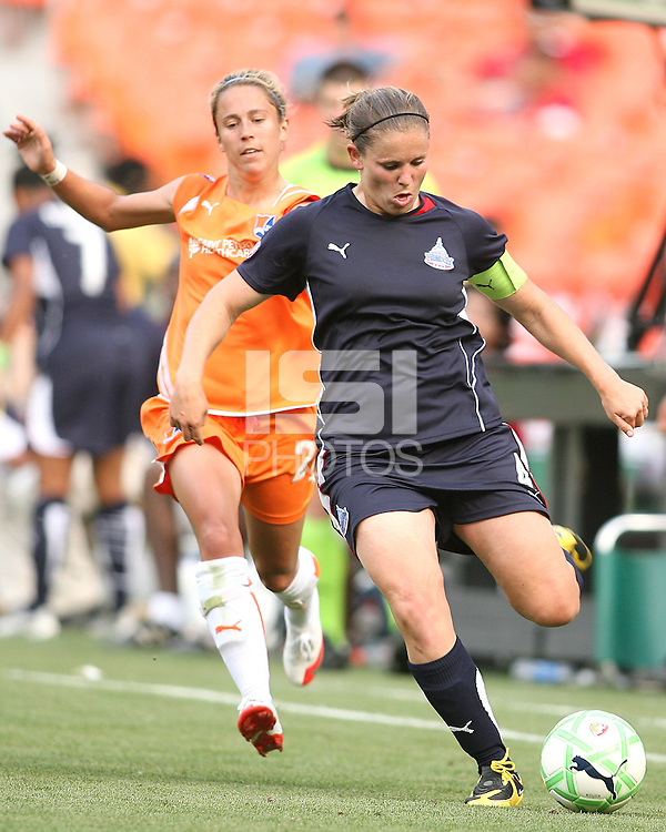 Cat Whitehill #4 of Washington Freedom gets away from Kacey White #20 of Sky Blue FC during a WPS match at RFK Stadium on May 23, 2009 in Washington D.C. Freedom won the match 2-1