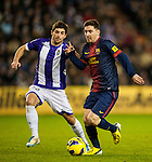 VALLADOLID, SPAIN - DECEMBER 22:  Lionel Messi (R) of Barcelona fights for the ball with Victor Perez of Valladolid at Jose Zorrilla on December 22, 2012 in Valladolid, Spain.  Photo by Victor Fraile / The Power of Sport Images