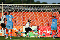 Sky Blue FC goalkeeper Jenni Branam (23) denies Ella Masar (55) of magicJack SC. Sky Blue FC and magicJack SC played to a 2-2 tie during a Women's Professional Soccer (WPS) match at Yurcak Field in Piscataway, NJ, on July 09, 2011.