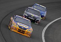Feb 22, 2009; Fontana, CA, USA; NASCAR Sprint Cup Series driver Michael Waltrip leads Jeremy Mayfield and Joe Nemechek during the Auto Club 500 at Auto Club Speedway. Mandatory Credit: Mark J. Rebilas-