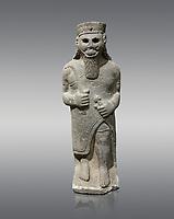 Hittite baslat sculptute of a male, late Hittite Period - 900-700 BC. Adana Archaeology Museum, Turkey. Against a grey background